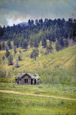 Jill Battaglia DERELICT CABIN BY HILL IN COUNTRYSIDE Houses