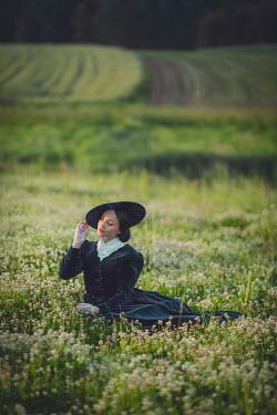 Joanna Czogala 19th century woman sat in field Women