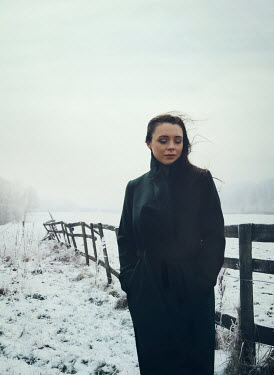 Mark Owen Woman stood in snowy countryside Women