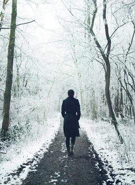 Mark Owen Woman walking in snowy forest Women