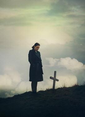 Mark Owen Woman stood over cross grave Women