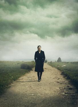 Mark Owen Woman walking on country path Women