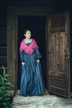 Magdalena Russocka historical woman standing at open door Women