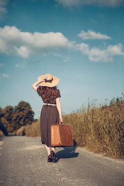 Magdalena Russocka vintage woman walking on country road Women
