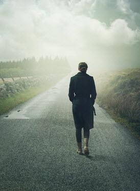 Mark Owen Woman walking down country path Women