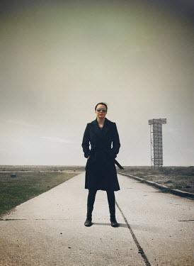 Mark Owen Woman stood on runway in field Women