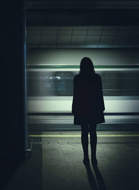 Magdalena Russocka silhouette of woman standing by subway Women