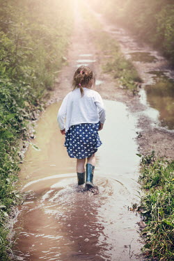 Evelina Kremsdorf LITTLE GIRL WITH WELLIES IN PUDDLE Children