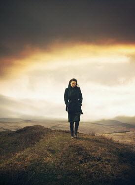 Mark Owen Woman walking on hilltop Women