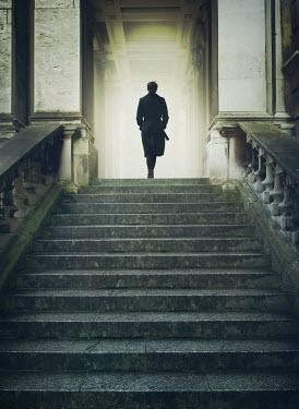 Mark Owen Woman walking into grand building Women