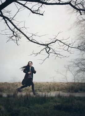 Mark Owen Woman running through country field Women