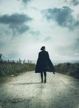 Mark Owen Woman walking through country lane Women