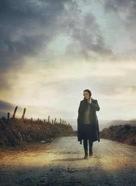Mark Owen Woman walking down country lane Women