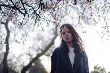 Anna Rakhvalova Brunette woman waiting under tree