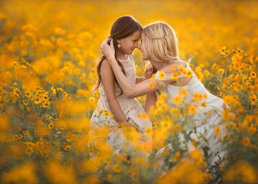 Lisa Holloway Girl with her mother in meadow of yellow flowers