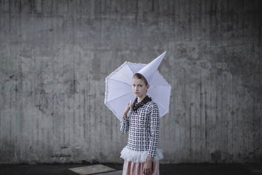 Dasha Pears Girl in party hat with white umbrella