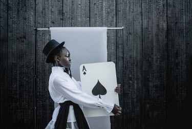 Dasha Pears Young woman holding oversized playing card