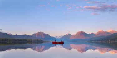 Lisa Holloway Girls in red rowboat on lake
