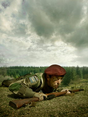 Stephen Mulcahey A british paratrooper  crawling along the ground