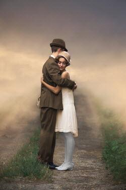 Ildiko Neer Vintage couple embracing countryside