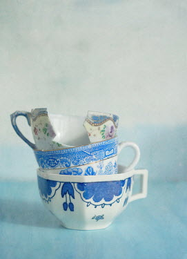 Jill Ferry BROKEN CUP IN STACK OF TEACUPS Miscellaneous Objects
