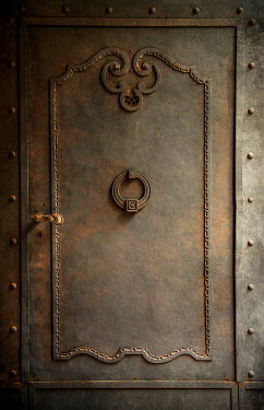 Jaroslaw Blaminsky CLOSE UP OF RUSTY DECORATIVE DOOR Building Detail