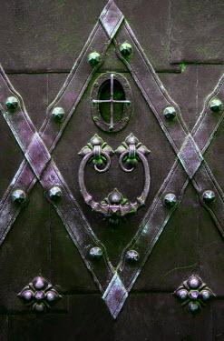 Jaroslaw Blaminsky CLOSE UP OF OLD DECORATIVE IRON DOOR Building Detail