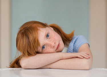 Lisa Holloway GIRL WITH RED HAIR AND FRECKLES LEANING ON TABLE Children