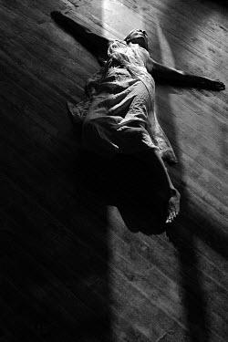 Virginia Ateh DEAD WOMAN LYIN ON FLOOR IN SHADOW Women
