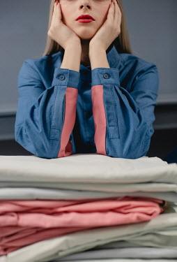 Dasha Pears Girl leant on pile of fabrics Women