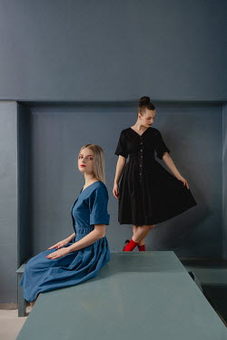 Dasha Pears Two women in dresses by bench Women