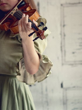 Elisabeth Ansley CLOSE UP OF GIRL PLAYING VIOLIN Women