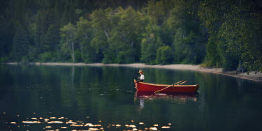 Lisa Holloway BOY ON BOAT FISHING IN LAKE Children