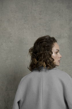 Virginia Ateh CLOSE UP OF BRUNETTE WOMAN IN JACKET FROM BEHIND Women