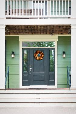 Evelina Kremsdorf WREATH ON DOOR OF WOODEN HOUSE Houses