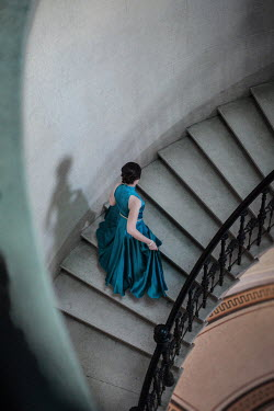 Nikaa WOMAN IN GOWN ON STAIRCASE FROM ABOVE Women