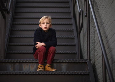 Lisa Holloway LITTLE BLONDE BOY SITTING ON METAL STEPS Children