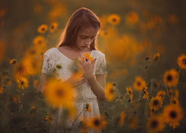 Lisa Holloway SAD GIRL STANDING IN FIELD OF SUNFLOWERS Children