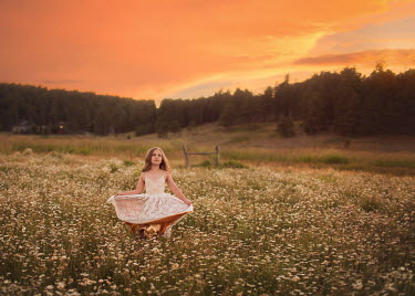 Lisa Holloway YOUNG GIRL DANCING IN SUMMERY FIELD AT SUNSET Children