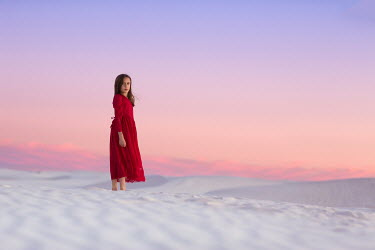 Lisa Holloway YOUNG GIRL STANDING IN DESERT AT SUNSET Children