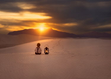 Lisa Holloway LITTLE BOY WITH LANTERN SITTING IN DESERT Children