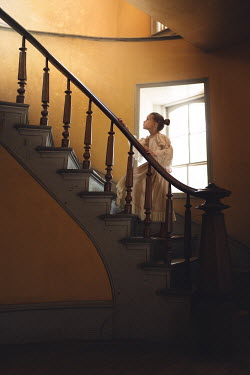 Lisa Holloway HISTORICAL GIRL CLIMBING STAIRCASE IN OLD HOUSE Children