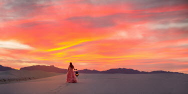 Lisa Holloway WOMAN WITH LAMP IN DESERT AT SUNSET Women