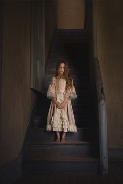 Lisa Holloway HISTORICAL GIRL STANDING ON STAIRCASE INDOORS Children