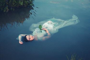 Joanna Czogala WOMAN WITH FLOWER FLOATING IN LAKE Women