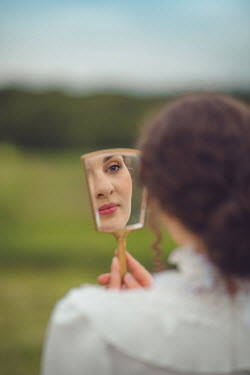 Joanna Czogala HISTORICAL WOMAN REFLECTED IN MIRROR OUTDOORS Women