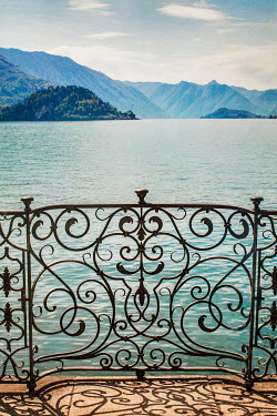 Nikaa DECORATIVE FENCE BY LAKE WITH HILLS Gates