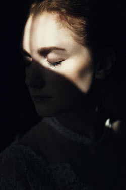 Magdalena Russocka woman in shadow with light on face