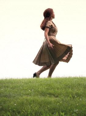 Elisabeth Ansley RETRO GIRL IN DRESS WALKING IN FIELD Women
