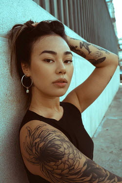 Greta Larosa ASIAN GIRL WITH TATTOOS SITTING IN CITY Women